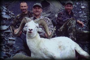 Joe Polunc (center) of Cologne, MN with guide Braun Kopsack (left) and assistant guide Dan Mielke (right) with his 160+ Dall Ram.